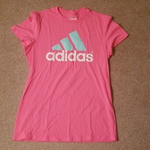 Pink adidas exercise shirt with green logo